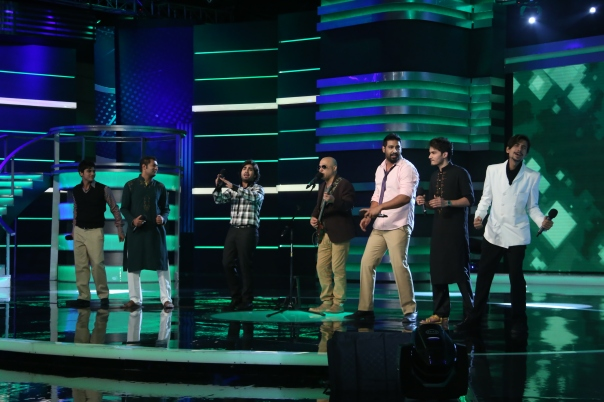 Ali azmat performing with the judges